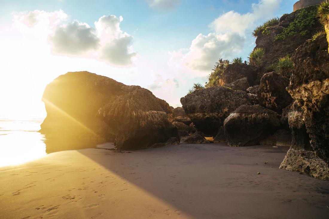 #ExploreJogjakarta #Jogjakarta #parangtritis Beach Beauty In Nature Calm Cloud Cloud - Sky Day Nature Non-urban Scene Outdoors Rock Formation Sand Scenics Sea Shore Sky Sunbeam Sunlight Sunny Tranquil Scene Tranquility Water Yellow