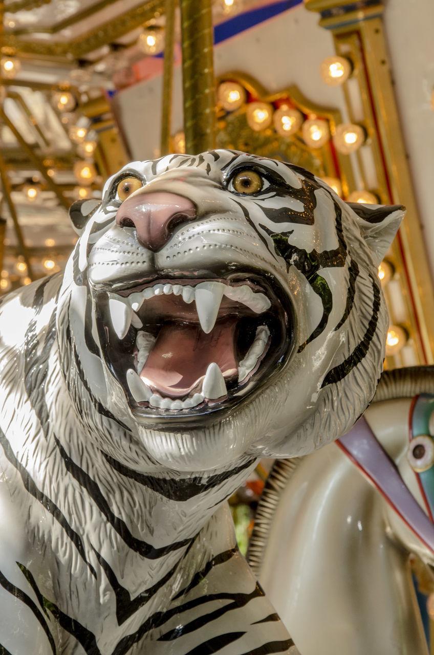 animal representation, indoors, carousel, no people, close-up, illuminated, day