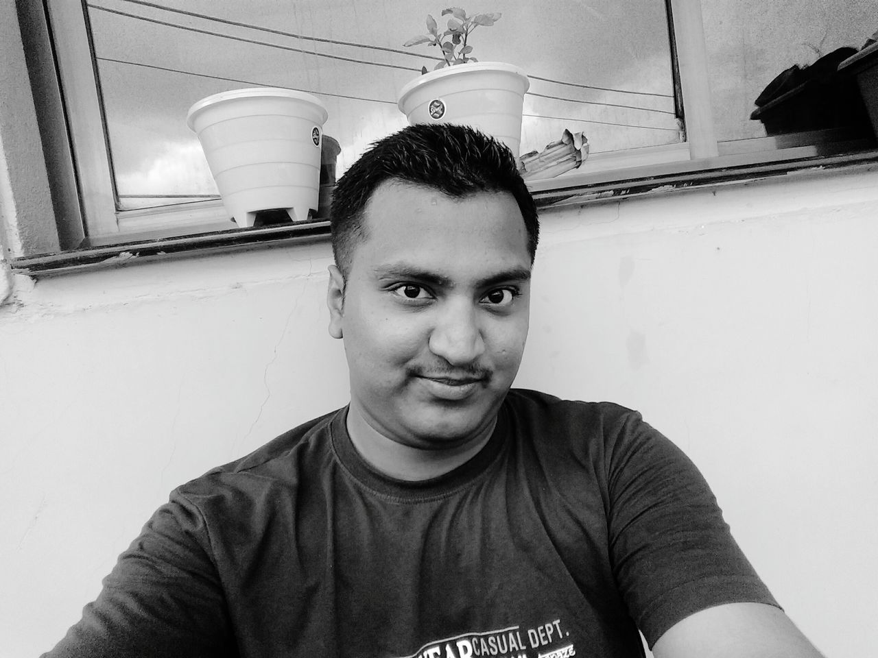 Looking At Camera Front View Portrait Casual Clothing Young Adult Handsome Lifestyles Big Eyes Moto G4 Plus Sports Wear Young Men Smile :) Dark Eyes Innocence Plant Pots Yellow Pot Straight Hair Monochrome Photography