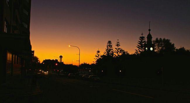 Overnight Success Silhouette Sunset Dark Road Orange Color Outline Building Exterior Sky Tranquil Scene Tall Calm Dusk