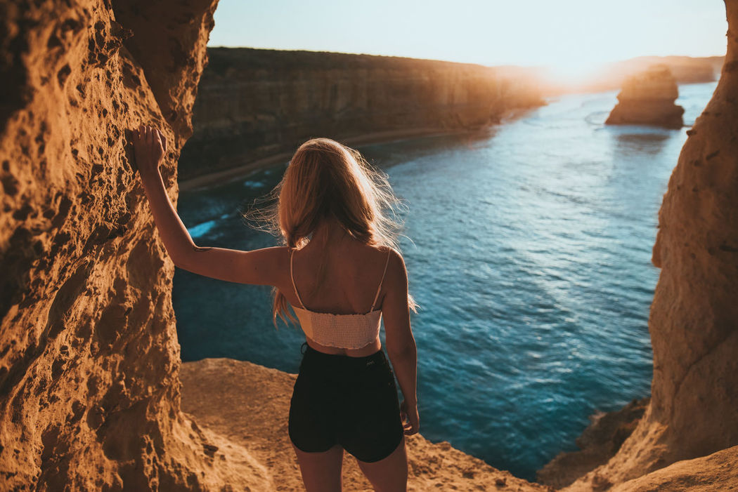 Australia EyeEm Best Shots Travel Travel Photography Beach Beauty In Nature Day Girl Horizon Over Water Leisure Activity Lifestyles Nature One Person Outdoors Real People Rear View Rock - Object Scenics Sea Sky Standing Sunlight Sunrise Vacations Water Women Young Adult Young Women