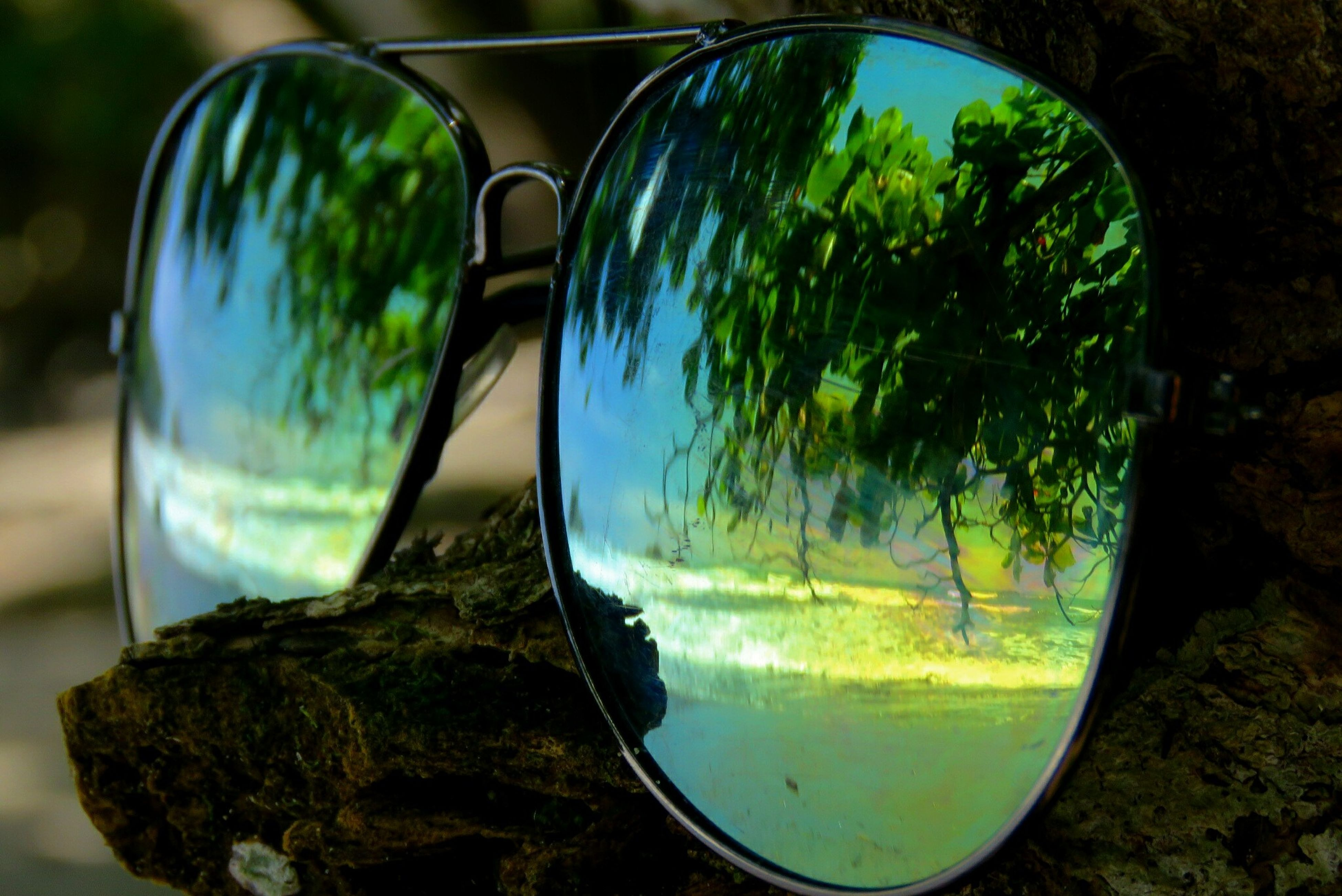reflection, transparent, glass - material, close-up, mode of transport, water, blue, focus on foreground, day, tranquility, no people, freshness, scenics, green color, beauty in nature