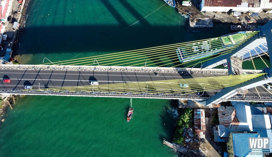 """""""Soekarno bridge from above"""" High Angle View Architecture Transportation Built Structure Outdoors Day Water No People Dji Dji Phantom DJI Phantom 3 Advanced Djiphotography Dronephotography Dronefly Aerial Photography Aerialphotography Bridge Landscape_photography Photography View From Above First Eyeem Photo Adapted To The City EyeEmNewHere"""