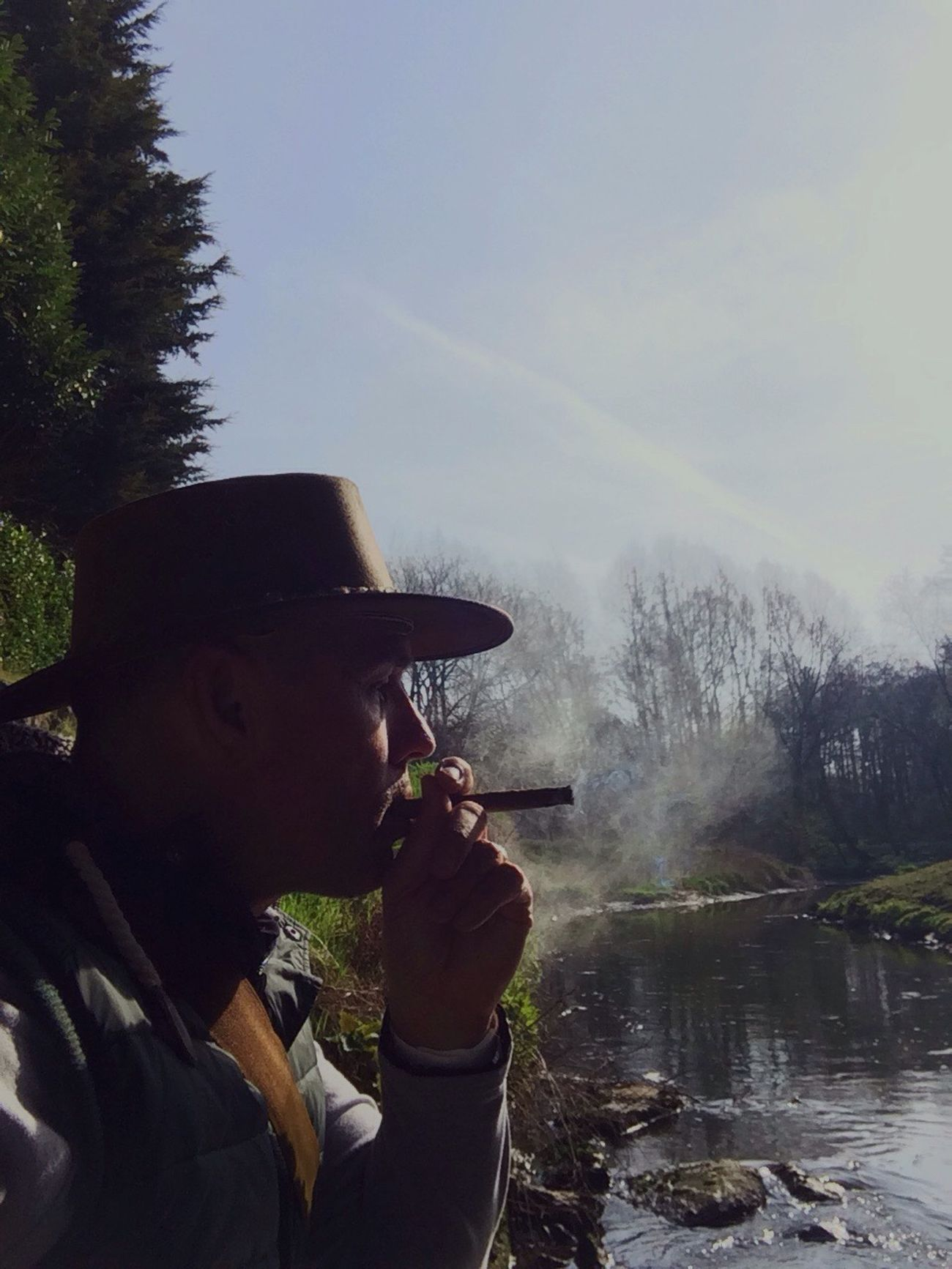 Having a break with a good smoke. Water Real People Tree One Person Leisure Activity Nature Day Outdoors Men River Beauty In Nature Scenics Sky