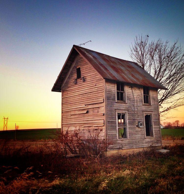 Rural Orange Co. Indiana abandoned small farm house. Landscape. Sunset