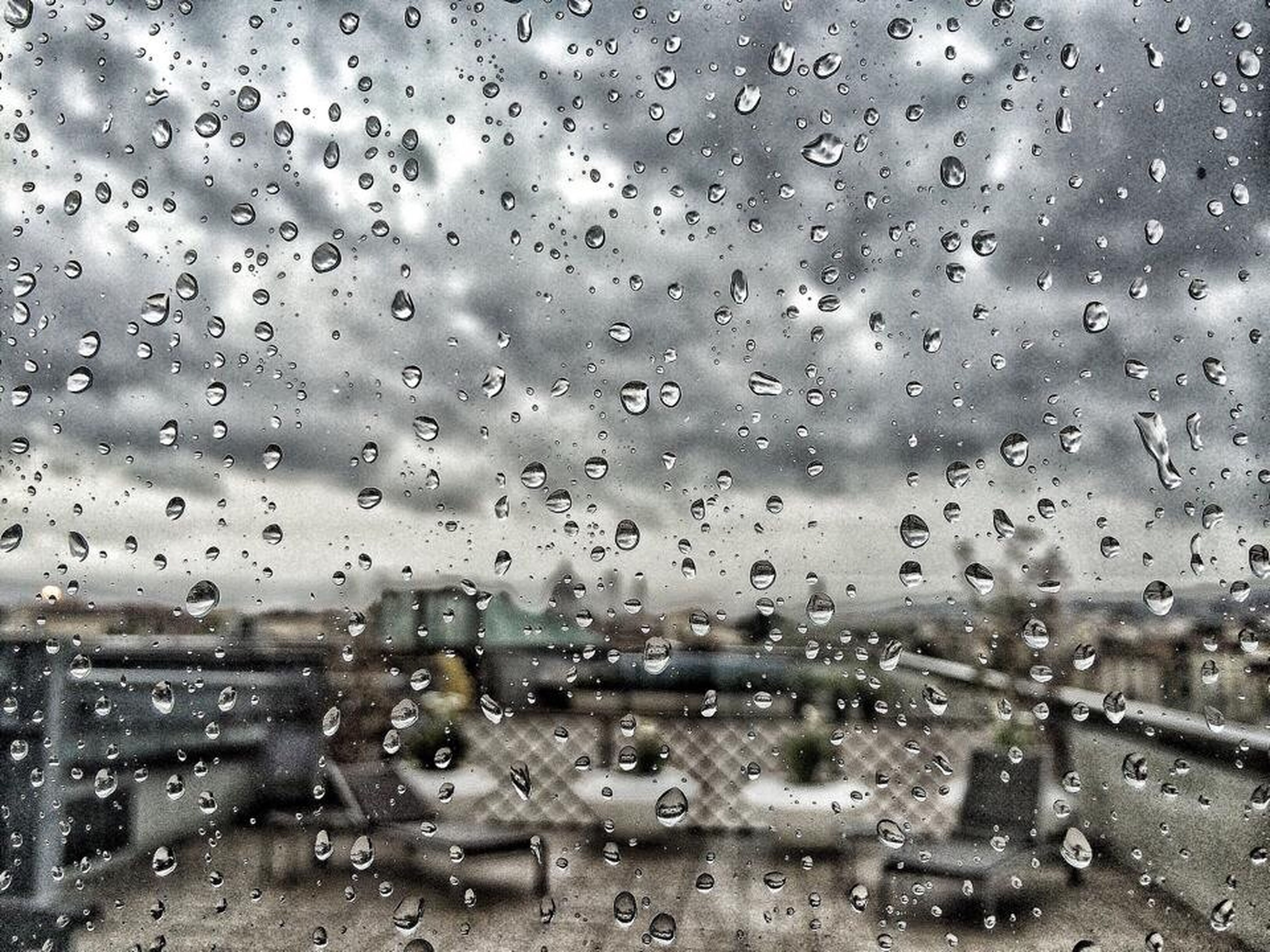 drop, wet, window, rain, water, indoors, weather, transparent, glass - material, raindrop, season, full frame, built structure, architecture, sky, backgrounds, building exterior, glass, city, monsoon