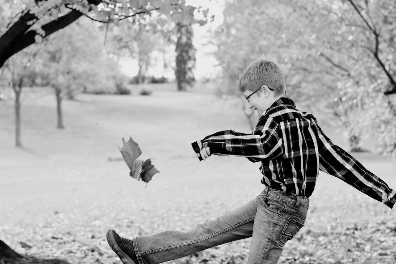 Kick. Tree Casual Clothing Autumn One Person Park - Man Made Space Leaf Nature People Outdoors Playing Day Bnw_friday_eyeemchallenge Bnw_leaves People In Places Childhood Photoshoot Child Happiness Lifestyles Monochrome Innocence Blackandwhite Black & White Photography Pennsylvania
