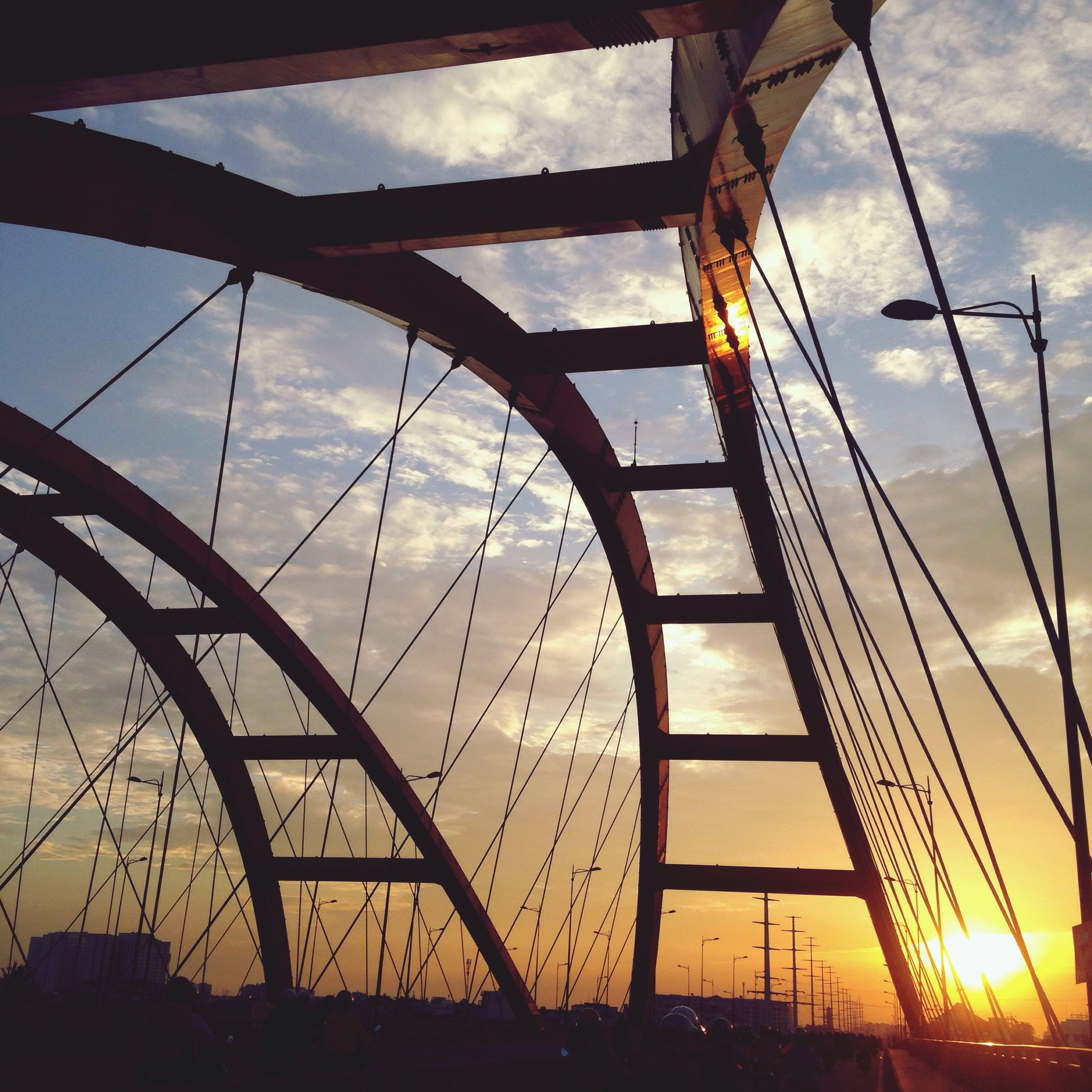 sky, cloud - sky, low angle view, outdoors, no people, sunset, ferris wheel, day, architecture, amusement park