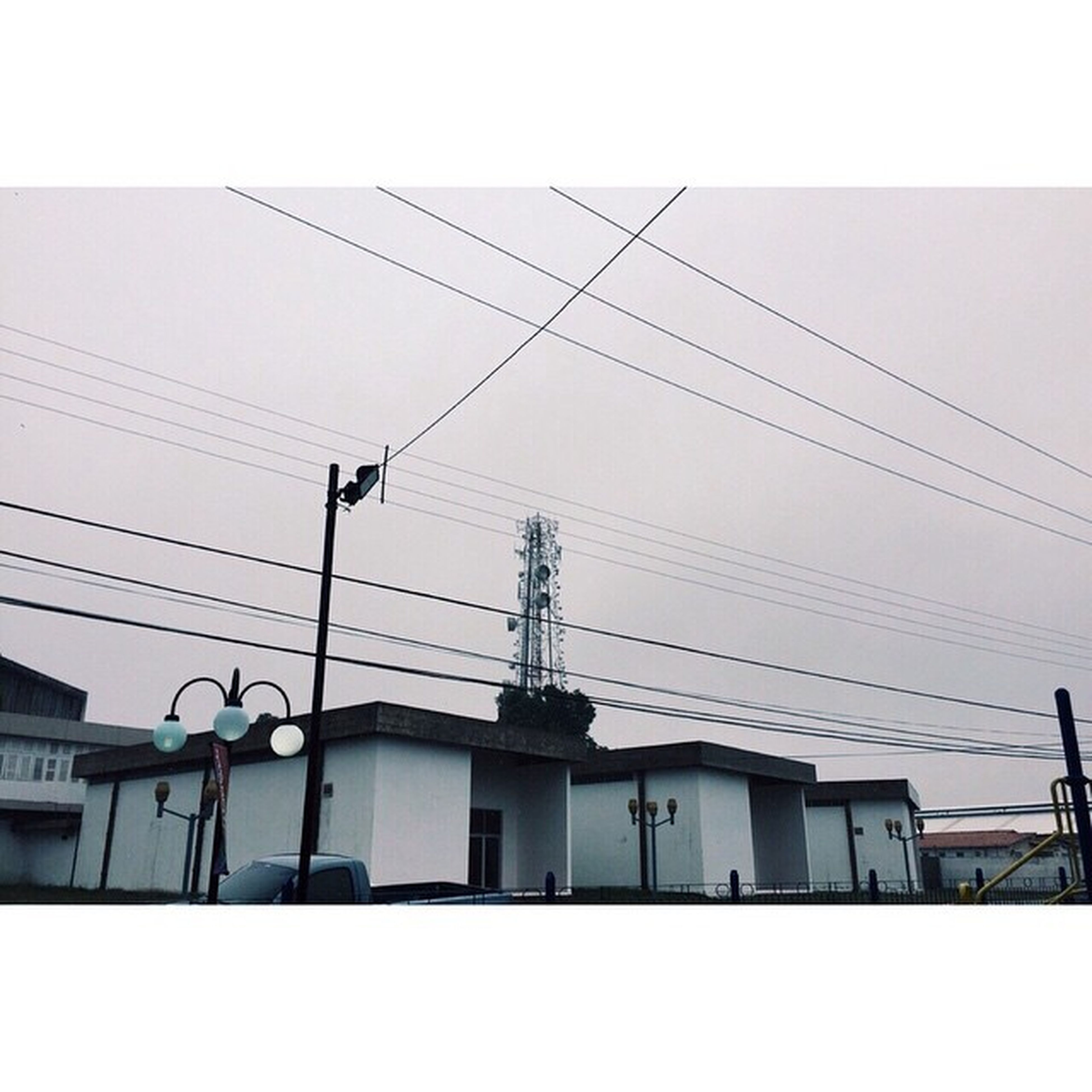power line, building exterior, built structure, architecture, electricity pylon, electricity, cable, power supply, low angle view, fuel and power generation, technology, connection, sky, power cable, clear sky, house, residential structure, residential building, transfer print, no people