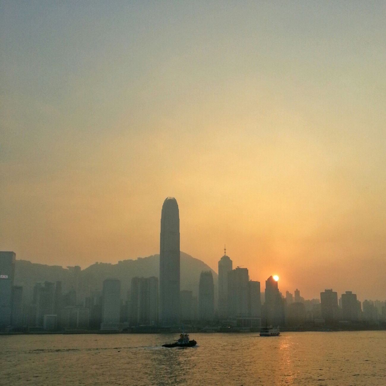 """Cause they know and so do I The high road is hard to find A detour to your new life Tell all of your friends goodbye"" Ocean Cityscape Skyporn Haze Sky_collection Sun_collection Highrises Broken Bells  Sunset Hong Kong"