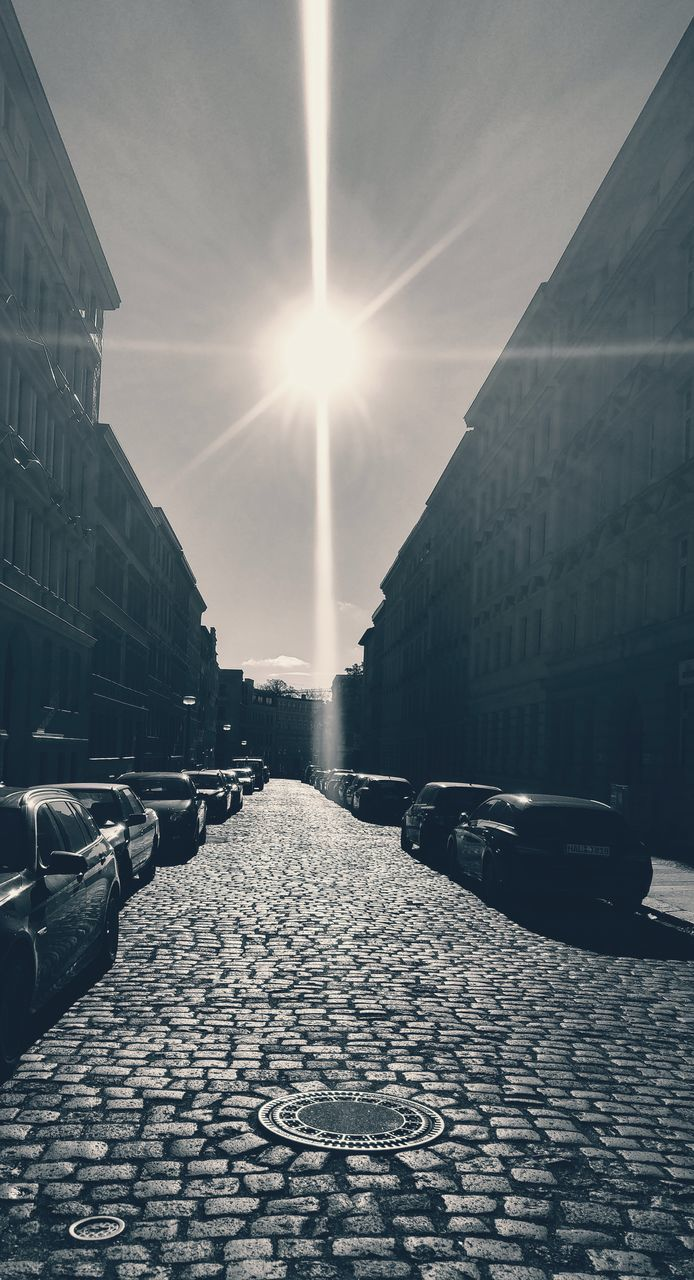 sun, architecture, sunlight, lens flare, building exterior, sunbeam, built structure, street, outdoors, city, day, no people, sky, nature