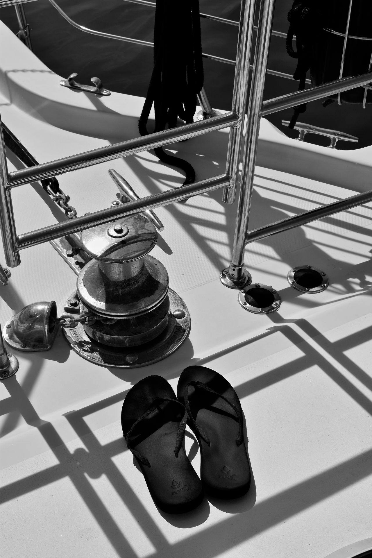 Flip Flops facing the anchor and the Gulf of Mexico Boat Deck Close-up Day Florida Life Gulf Of Mexico Low Angle View Low Section Monochrome Photograhy Monochrome Photography Nautical Vessel No People Outdoors Pulley Rigging Sandles Sky Vertical Yachting