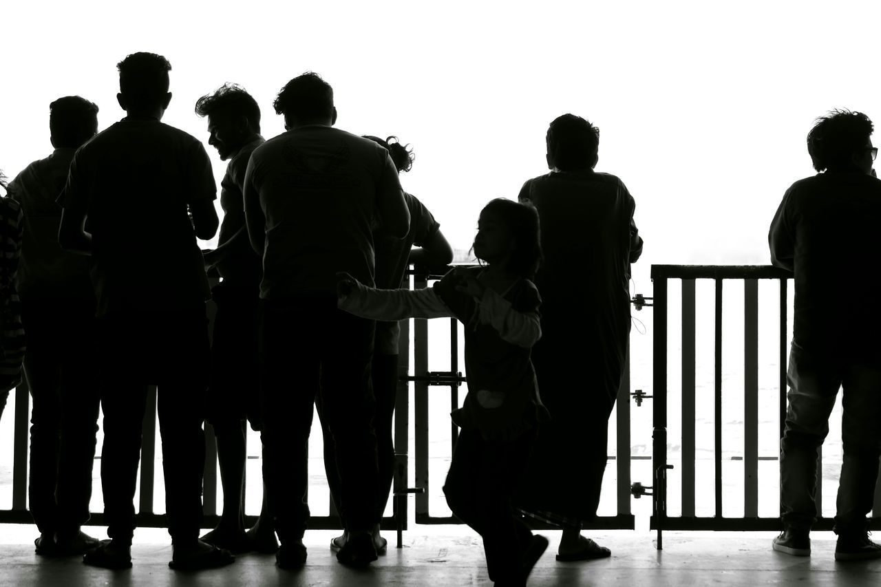 Silhouettes Silhoutte Photography People Group Of People Looking Out Railings Lightning Light And Shadow Facing Away Facing The Ocean Group Group Silhouettes Of People Silhouette Photography Sharing Views Light And Shadows Light And Dark People And Places