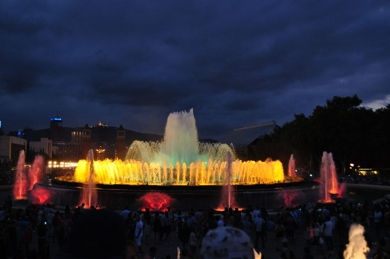 Arts Culture And Entertainment Barcelona Barcelona, Spain Celebration City Cloud - Sky Crowd Enjoyment Event Fountain Fountain Show Fuente Magica Illuminated Large Group Of People Las Fuentes Mágicas Leisure Activity Motion Multi Colored Night Night Show Sky Summer Travel Destinations