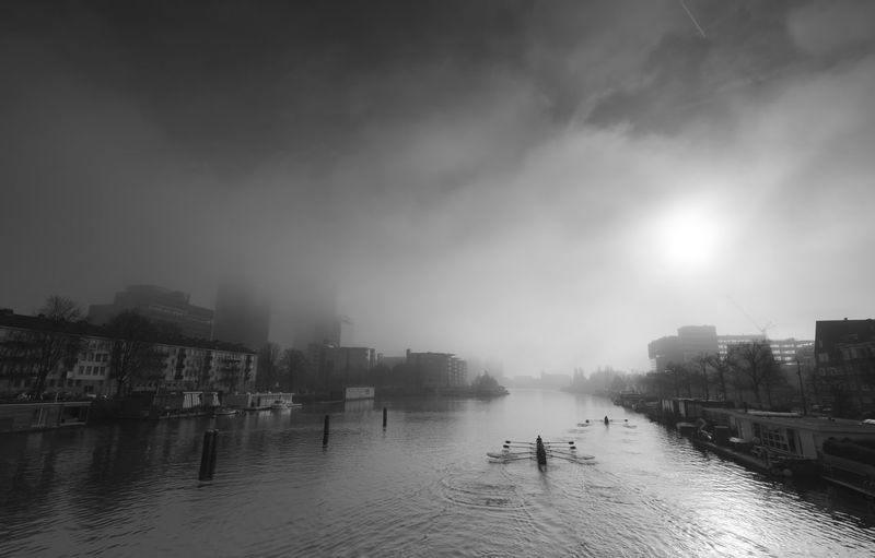 Amstel Amsterdam Amsterdam <3 Architecture Boat Built Structure City City Day Fog Foggy Netherlands Netherlands ❤ Outdoors People River Rowboat Rowing Sky Sports Water