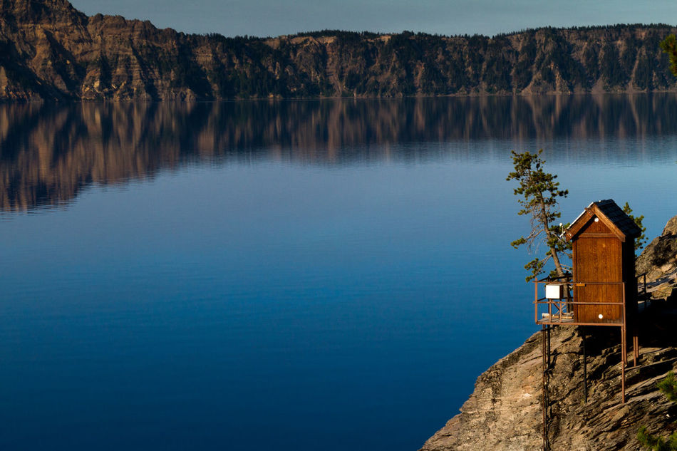 Tiny wooden structure on the edge of Crater Lake, Oregon. Imagine waking up to this view everyday. Amazing View Beauty In Nature Blue Built Structure Crater Lake Crater Lake National Park In Nature  Lake Landscapes Lifestyles Morning View Nature Nature On Your Doorstep No People On The Water Oregon Outdoors Scenics Tiny House  Tranquility Travel Water Waterfront Wooden House