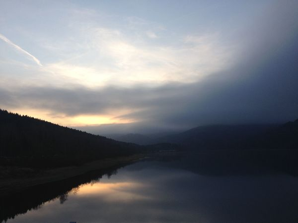 Beauty In Nature Day Lake Mountain Nature No People Outdoors Reflection Scenics Silhouette Sky Sunset Tranquil Scene Tranquility Water Waterfront