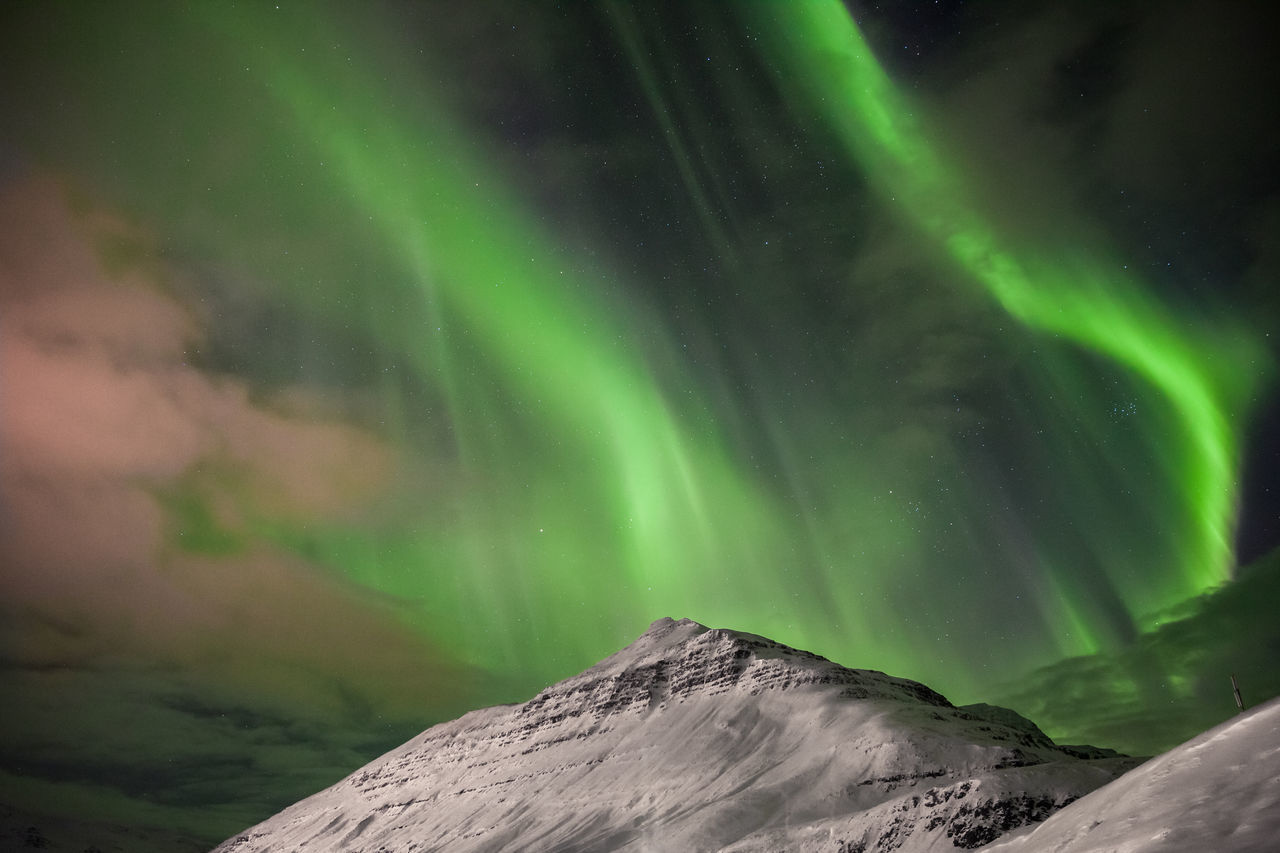 Aurora Borealis - Iceland Aurora Aurora Borealis astronomy aurora polaris awe beauty in Nature Dramatic sky Green color landscape Low angle view majestic mountain natural phenomenon Nature night no people outdoors scenics sky snow space star - space tranquil scene Tranquility Winter