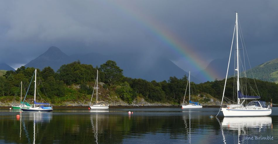Breathtaking Environment Freshwater Lake Landscape Loch Leven Mountain Nautical Vessel No People Peace And Quiet Rainbow Recreational Boat Reflection Sky Stunning Summertime Water Yachts