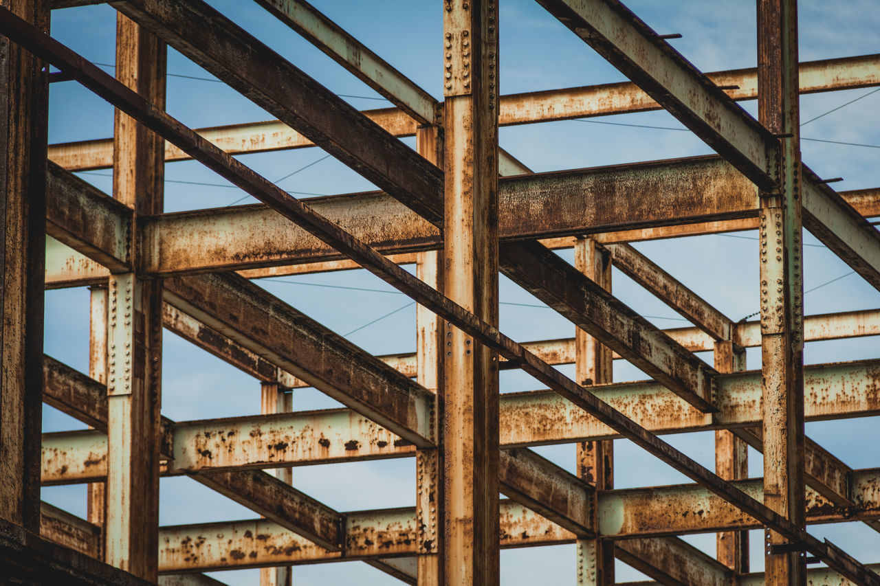 rusty, day, full frame, no people, low angle view, sky, backgrounds, outdoors, architecture, close-up, girder