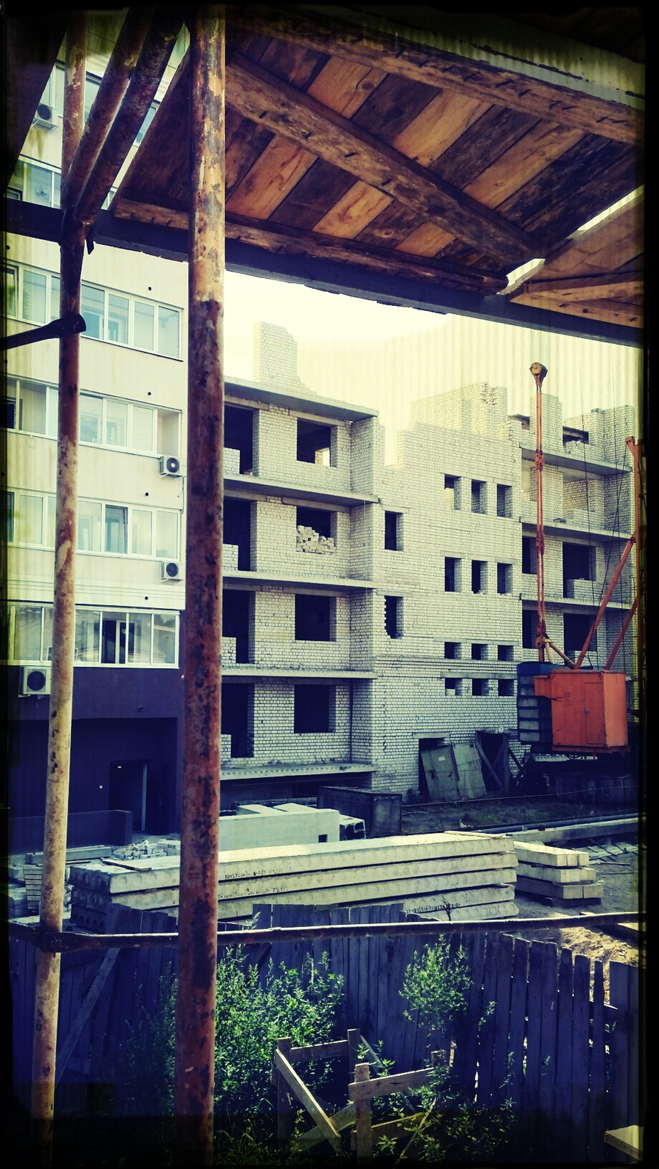 architecture, built structure, building exterior, window, house, residential structure, residential building, building, abandoned, old, day, no people, damaged, obsolete, outdoors, balcony, exterior, run-down, roof, sunlight