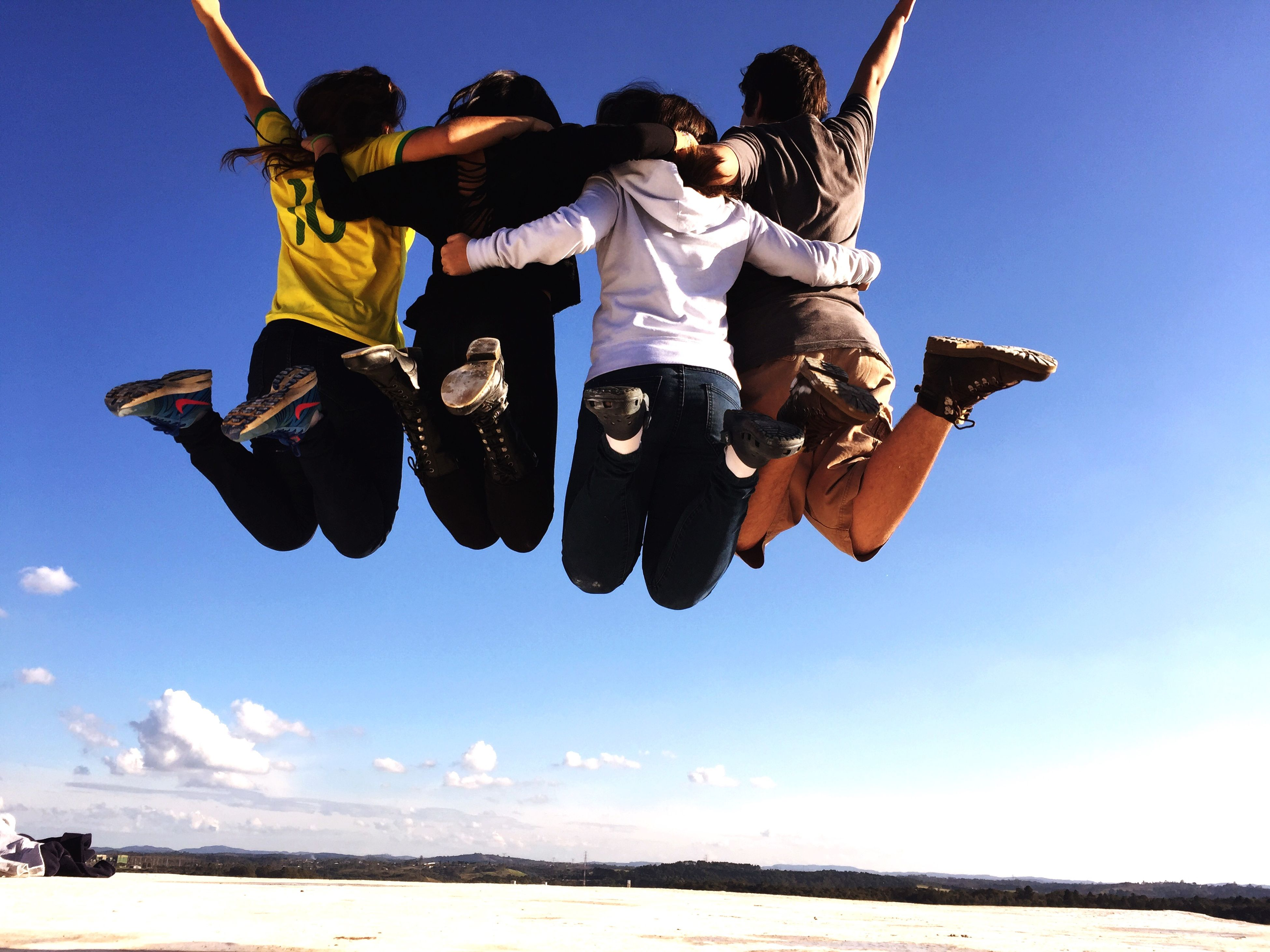 leisure activity, lifestyles, extreme sports, fun, enjoyment, mid-air, men, full length, vacations, blue, jumping, sport, adventure, clear sky, sky, skill, beach
