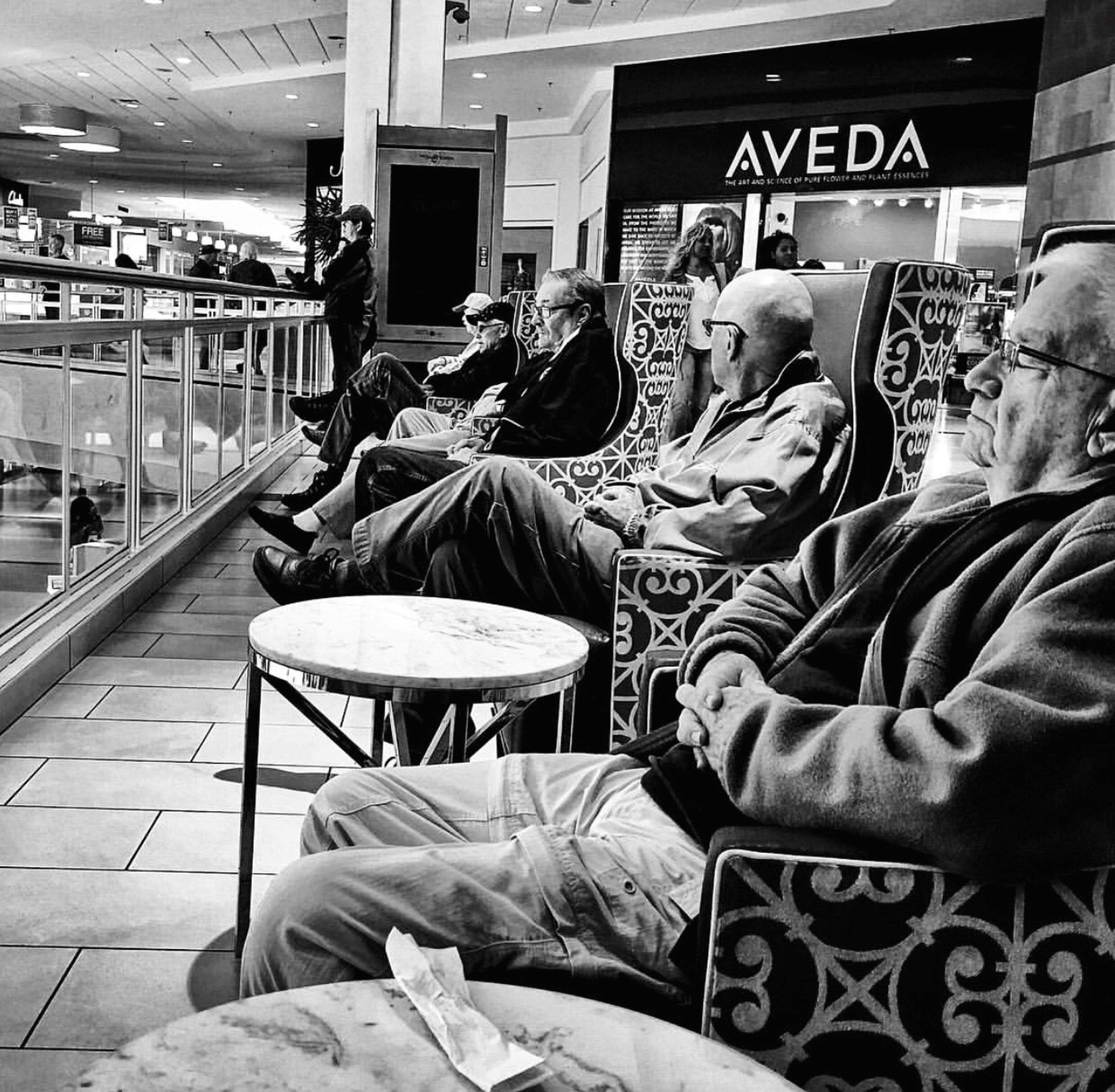 men, retail, lifestyles, market, indoors, market stall, occupation, casual clothing, store, sitting, rear view, incidental people, small business, working, shopping, business, city
