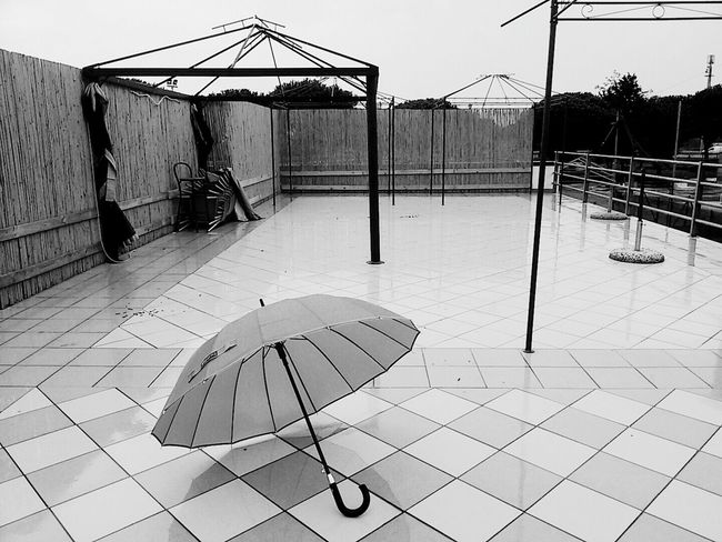 Outdoors Photo Of The Day EyeEm Bnw Floor Patterns Cloudy Sky Streetphotography_bw Geometric Forms Monochrome Gazebo View Ombrella Welcome Weekly The Purist (no Edit, No Filter) Minimalism_bw Raining Outside Eyeemphotography EyeEm Market ©