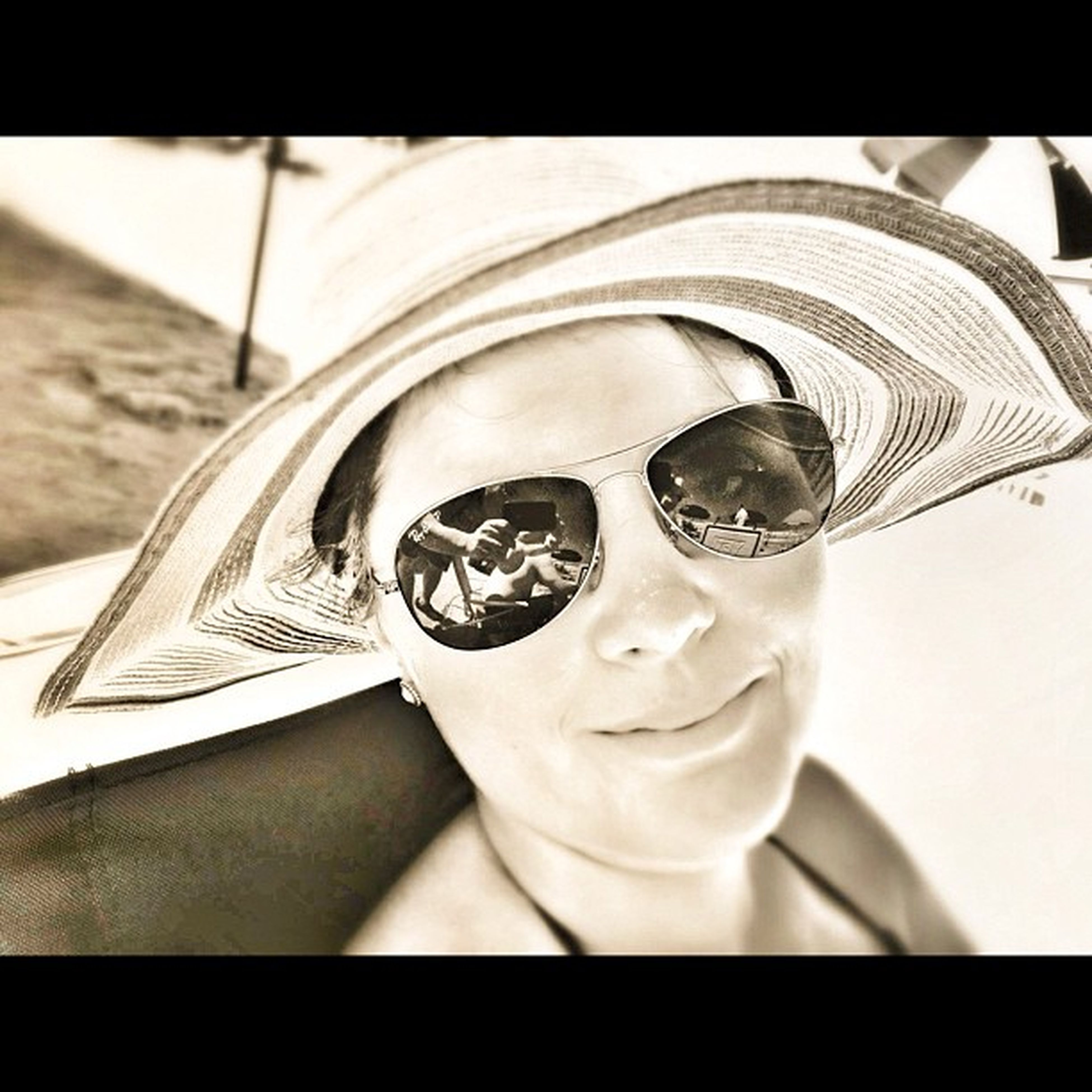 close-up, sunglasses, focus on foreground, looking at camera, indoors, portrait, one person, auto post production filter, reflection, day, front view, car, hat, human representation, photography themes, transfer print, headshot, sunlight, sculpture