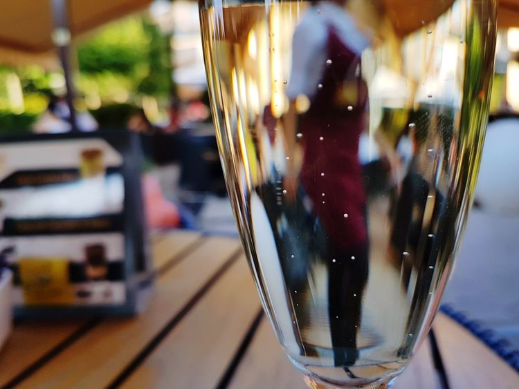 Drink Drinking Glass Food And Drink Table City Mix Yourself A Good Time The Week On EyeEm EyeEmNewHere Prosecco Bubbles Bubbles In Glass Reflection People Reflections Woman Reflected Leisure Activity Relaxing Drinking Lifestyle Paint The Town Yellow Rethink Things