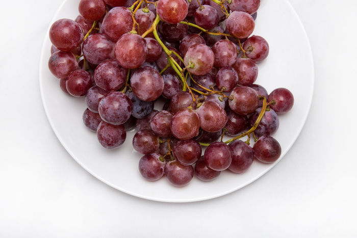 bunch of grapes Abundance Bunch Of Grapes Close-up Food Food And Drink Freshness Fruit Fruit Bowl Grape Group Of Objects Healthy Eating Indulgence Large Group Of Objects Medium Group Of Objects No People Plate Ready-to-eat Red Serving Size Studio Shot Temptation White Background