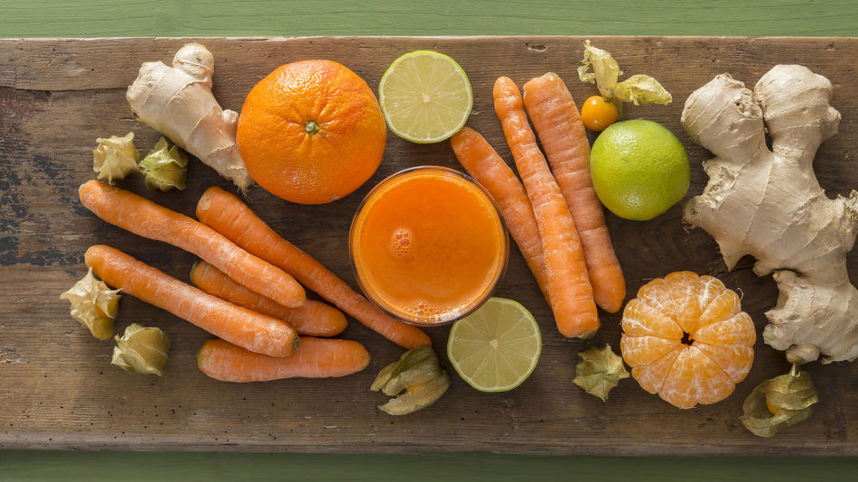 Carrot Juice Citrus Fruit Day Food Freshness Fruit Fruit Juice Healthy Eating High Angle View Indoors  No People SLICE Vegetable Vegetable Juice Vegetarian Wood - Material