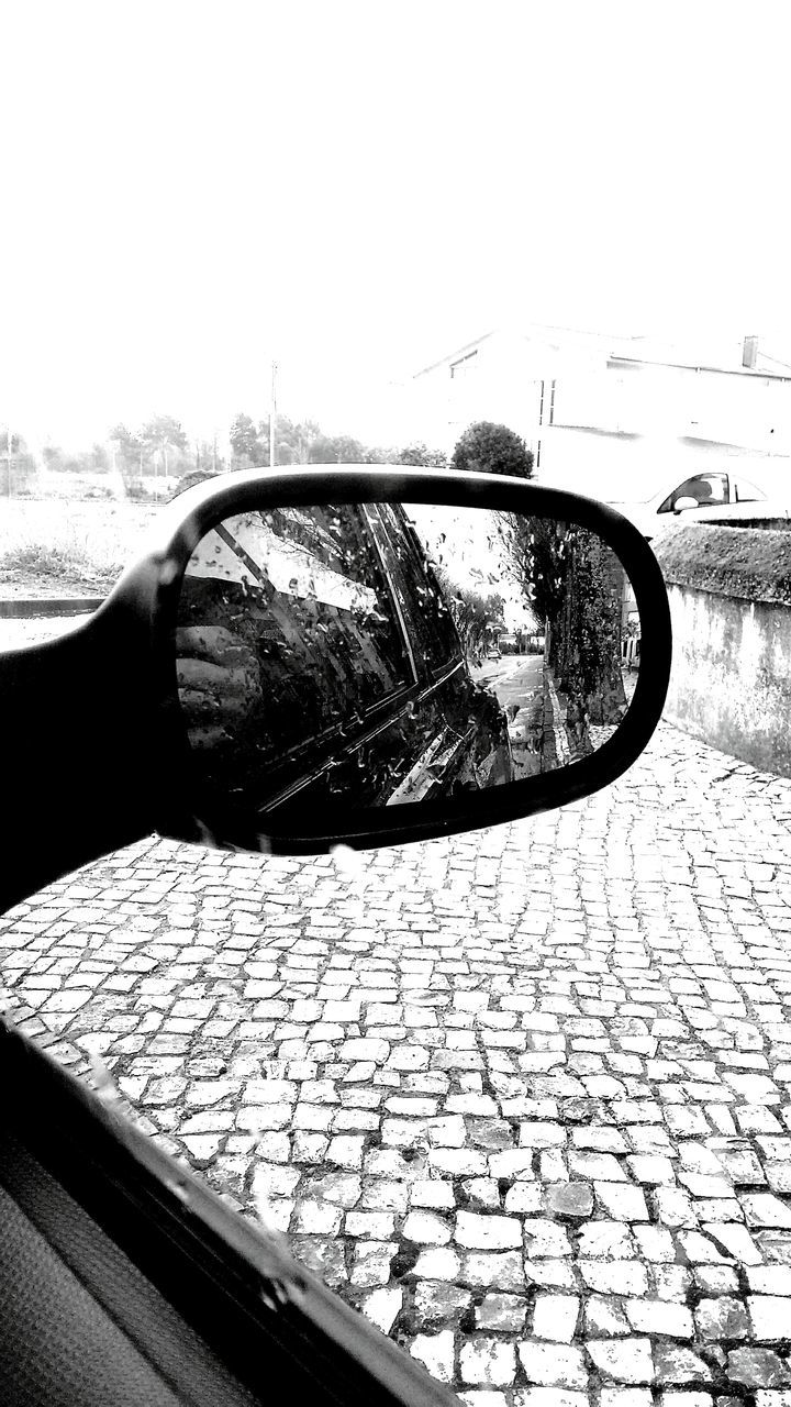 transportation, day, mode of transport, outdoors, side-view mirror, reflection, car, no people, land vehicle, close-up, sky, nature