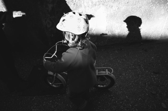 learning freedom Bicycle Bike Child Childhood Cycling CyclingUnites Cyclist Darkness And Light Hand Helmet Kid Leisure Activity Lifestyles Light And Shadow Monochrome Photography On Your Bike Outdoors People Real People Shadow Silhouette Togetherness Wall Young