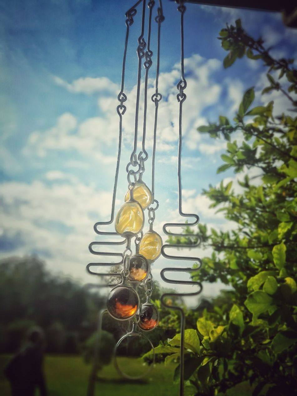 Golden artifacts Hanging Swing Chain Sky Day Tree No People Outdoors Rope Swing Close-up Nature