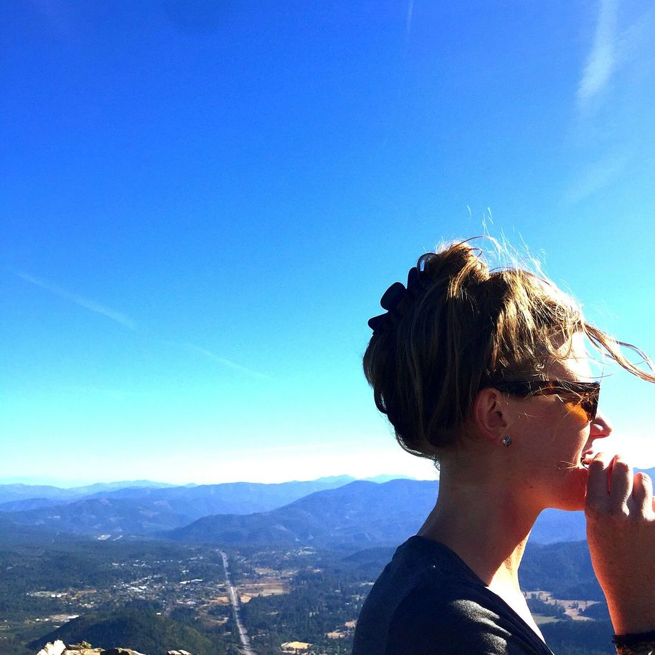when youve made it to the top. A dried mango is in order. This is Erica. California Climb Stillness Reward Windblown Driedmango Sunglasses Nature Young Adult Close-up Sky Scenics Outdoors Blue Headshot One Person Beauty Happiness Mount Shasta, California