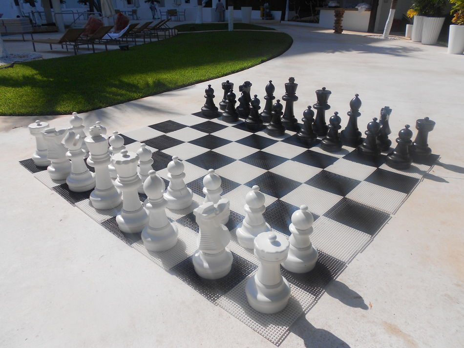 Giant outdoor chess set Black And White Board Games Chess Chess Board Giant Chess Giant Chess Set Giant Chessboard No People Outdoor Activity