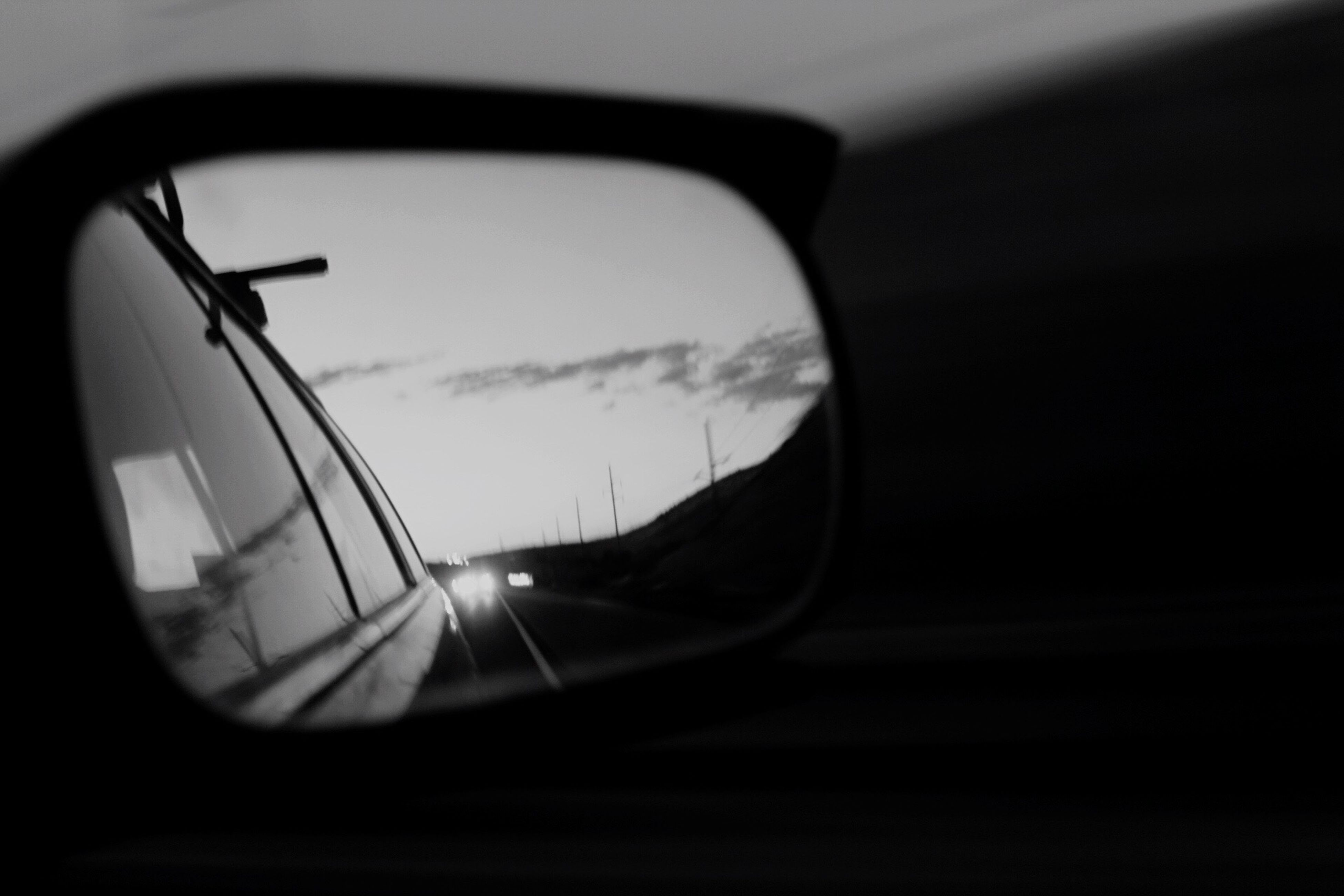 reflection, transportation, close-up, car, land vehicle, side-view mirror, sunset, sky, vehicle mirror, mode of transport, vehicle interior, car interior, glass, road, rear-view mirror, no people, tree, day, semi-circle, outdoors