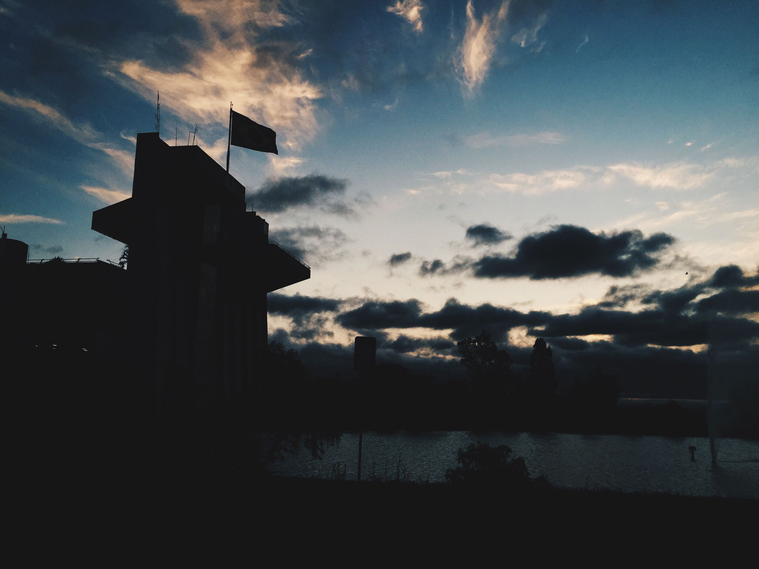 silhouette, sky, building exterior, sunset, built structure, architecture, cloud - sky, water, dusk, cloud, tranquility, scenics, tranquil scene, beauty in nature, nature, sea, outdoors, no people, reflection, outline