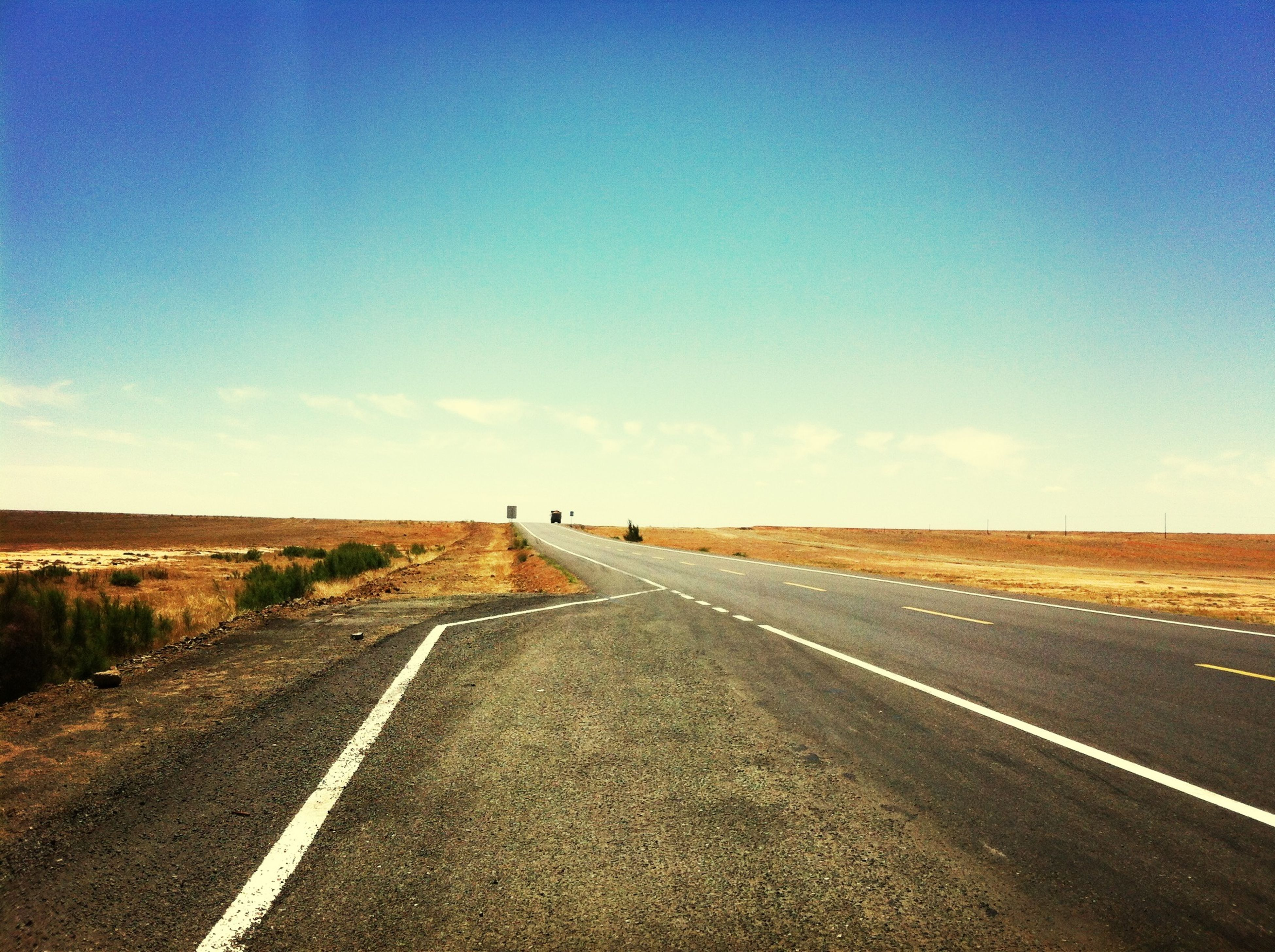 the way forward, road, transportation, diminishing perspective, road marking, vanishing point, country road, sky, landscape, empty road, asphalt, empty, tranquil scene, long, tranquility, horizon over land, highway, blue, nature, copy space