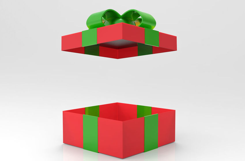 A opened Red present or gift box with green ribbon on gray background. Christmas Gift concept Bow Box Celebration Christmas Copy Space Glitter Happy Holiday New Xmas Birthday Blank Color Decorative Design Empty Gift Object Open Package Present Red Ribbon - Sewing Item Studio Shot White Background