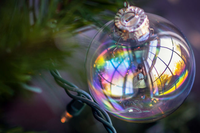 Window Ornament Bubble Bubble Wand Circle Close-up Colorful Crystal Ball Day Focus On Foreground Fragility Geometric Shape Glass - Material Globe - Man Made Object Lens Flare Multi Colored Outdoors Reflection The Culture Of The Holidays Transparent