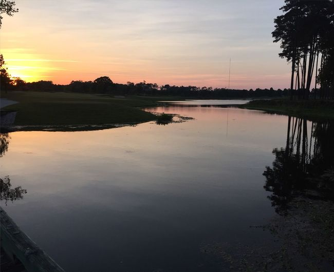 Golf Course Sunset Over Water