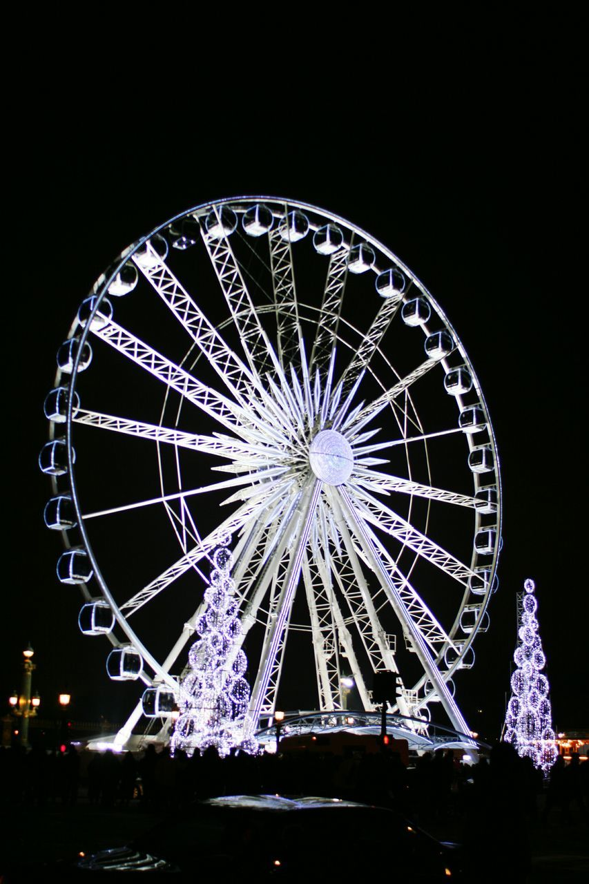 night, ferris wheel, arts culture and entertainment, illuminated, amusement park, low angle view, amusement park ride, outdoors, big wheel, sky, architecture, built structure, no people, building exterior, city