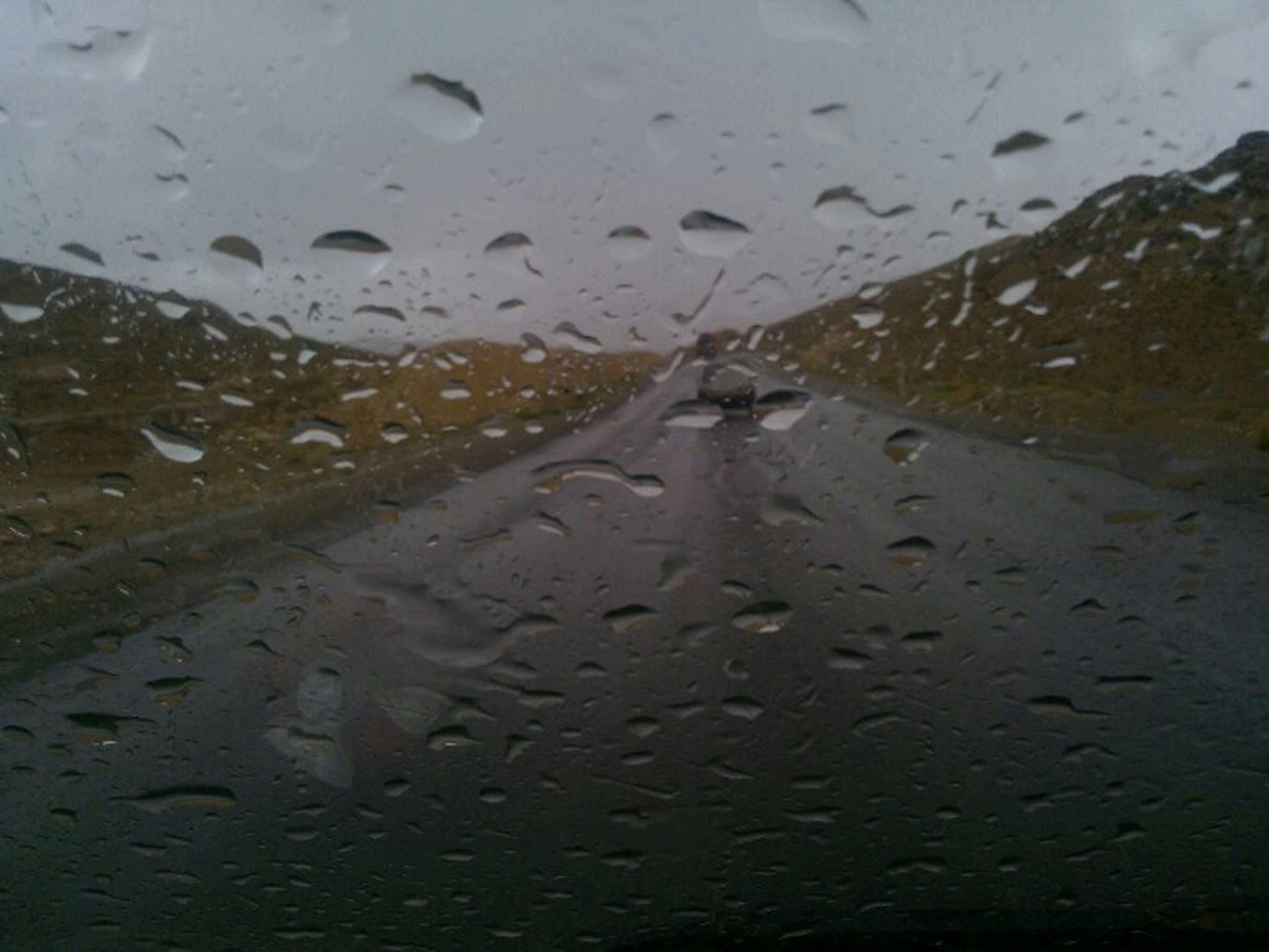 wet, water, rain, transportation, weather, season, drop, street, road, mode of transport, monsoon, the way forward, land vehicle, car, sky, window, raindrop, puddle, reflection, rainy season