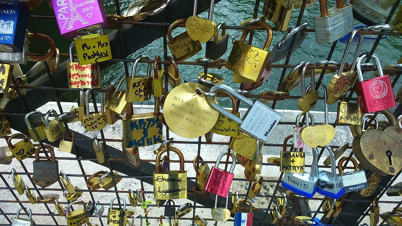 large group of objects, abundance, padlock, variation, hanging, metal, no people, text, love, safety, day, lock, outdoors, love lock, protection, hope, choice, luck, close-up