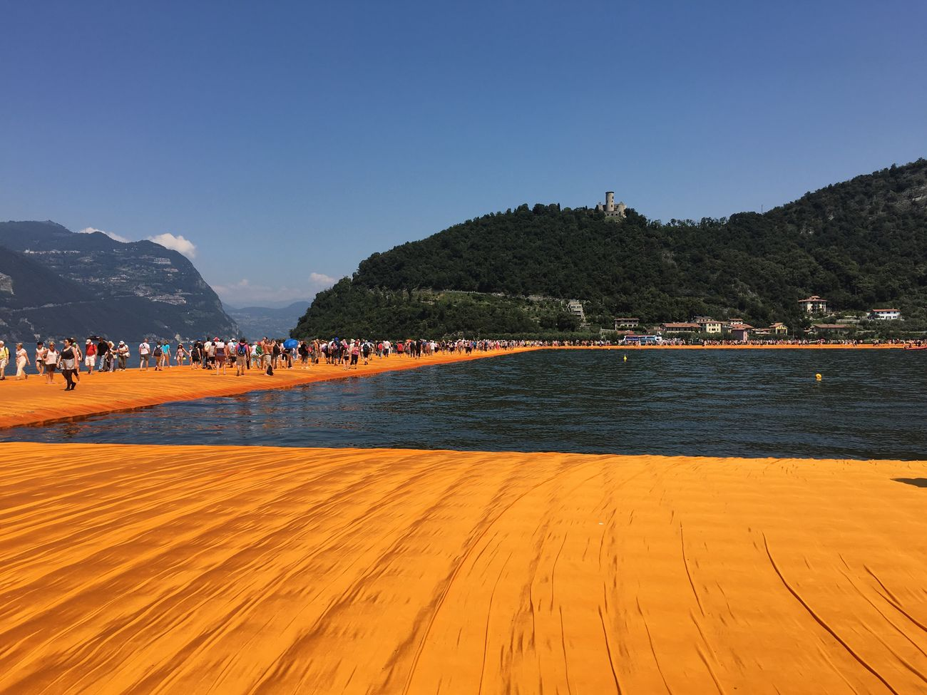 Iseo Lake Installation Art Memories Of Summer Summer2016 Ponte Galleggiante Ponte Di Christo ArtWork Orange Blue Bridge Water Mountain Sky Clear Sky Amazing Place People Walking On The Water