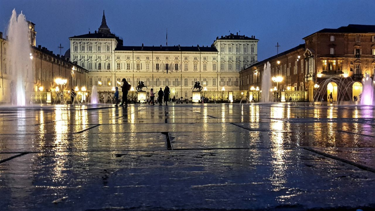 Embrace Urban Life Rainy Weather Square Piazza Castello Turin Royal Palace Architecture Building Exterior Wet Paving Slabs Water Wet City Fountains Outdoors Night People Reflections Night Photography