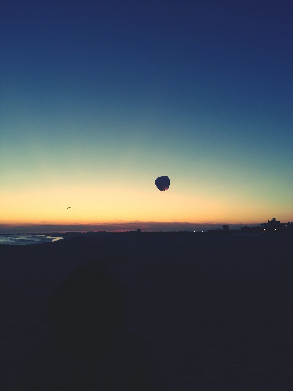 sunset, silhouette, hot air balloon, tranquil scene, nature, beauty in nature, scenics, tranquility, mid-air, outdoors, landscape, sky, no people, flying, clear sky, day