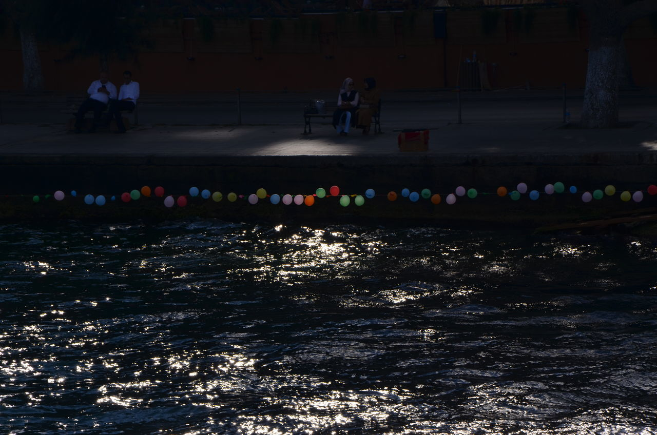 Balloons Capture The Moment Istanbul Men Vs Women Sea Turkey Traveling Men Women Sitting Water Light Colors Colorful Streetphotography Street Photography TakeoverContrast Finding New Frontiers The City Light EyeEm Diversity